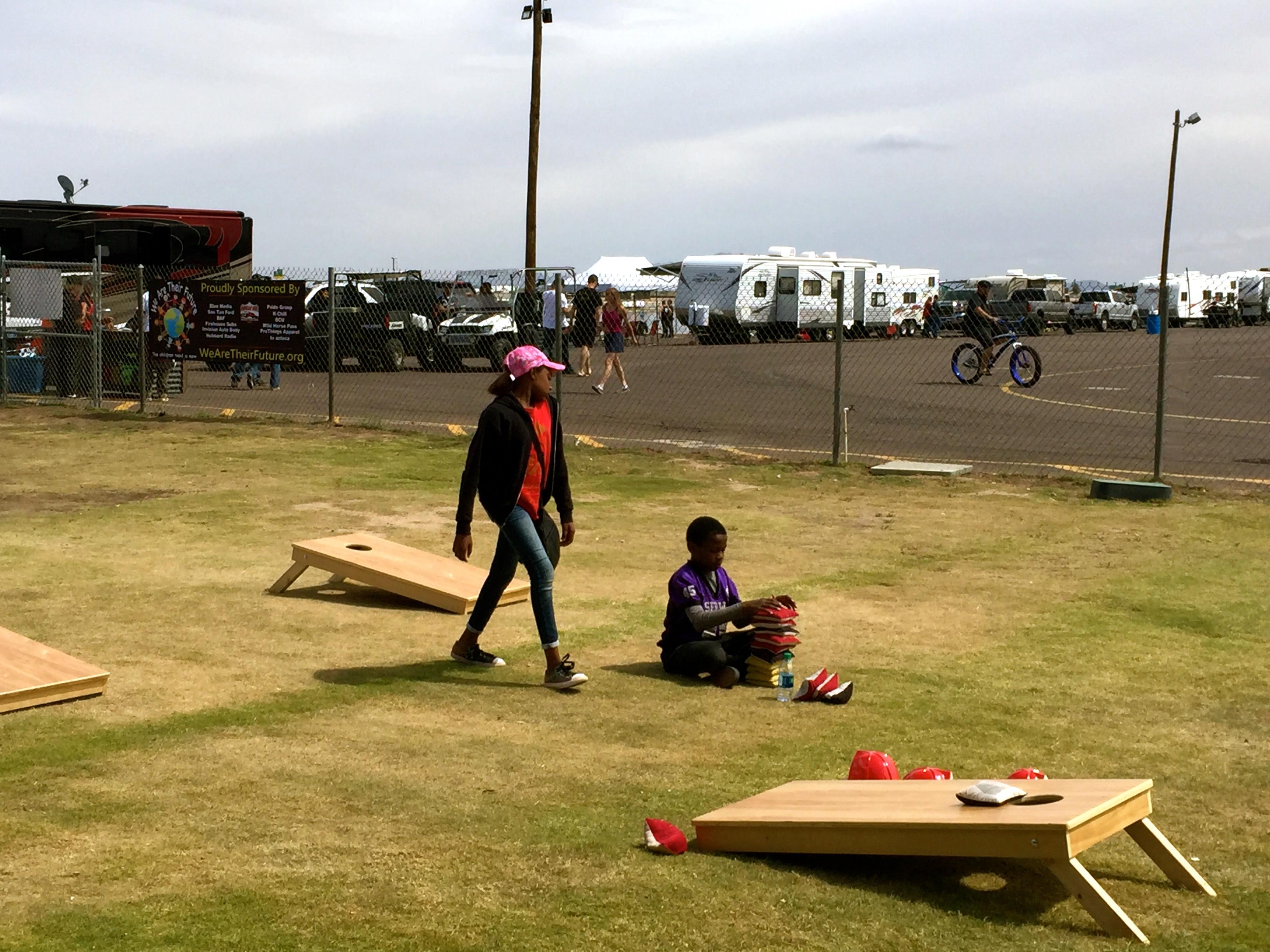 Foster children playing cornhole